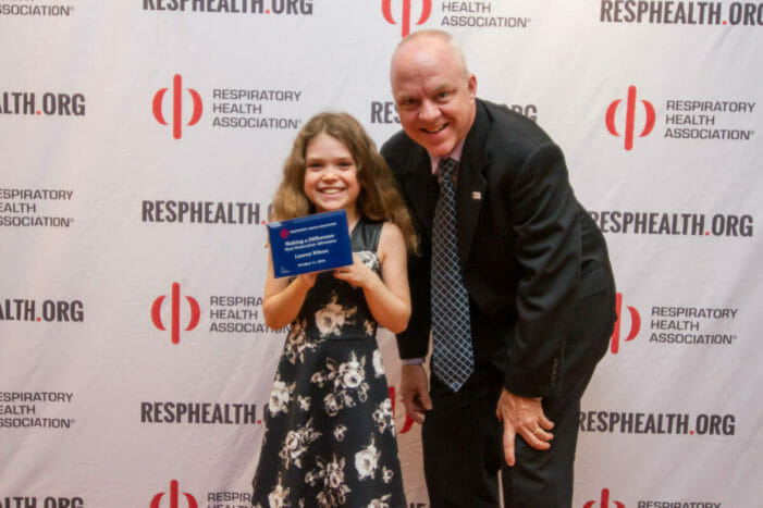 Youth advocate and policy director pose with award for efforts to support lung health