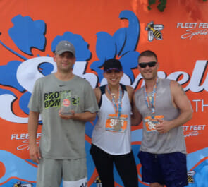 Runners pose after running half marathon