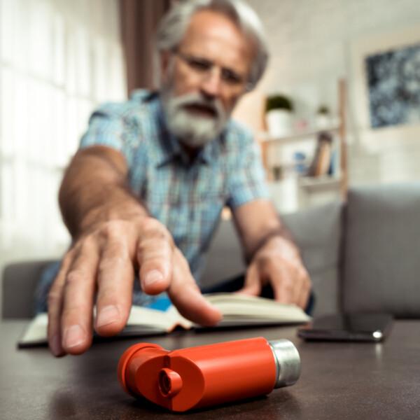 adult man inhaler asthma